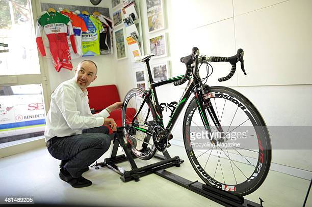 Italian bike fitter Giuseppe Giannecchini photographed while working on a Genesi carbon road bike at the Formigli Bikes workshop in Florence, on...
