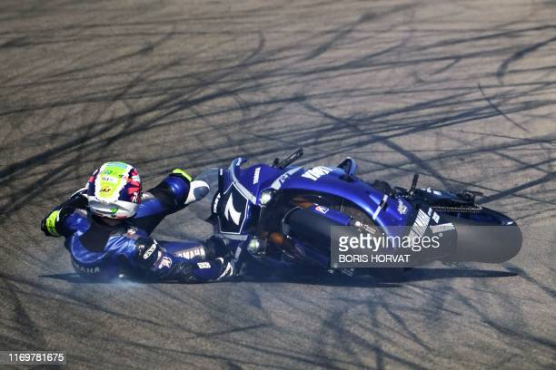 Italian biker Niccolo Canepa falls from his Yamaha YZF-R1 during a free session of the 83rd Bol d'Or 24-hour motorbike endurance race, at the...
