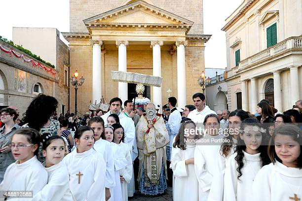 Italian bishop Vito Angiuli starting the procession of Corpus Christi The Feast of Corpus Christi is celebrated the thursday after Trinity Sunday...