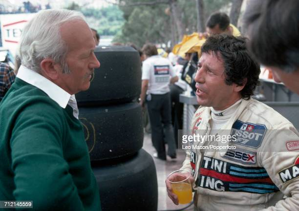 Formula One driver Mario Andretti of the United States and Colin Chapman founder of Lotus Cars pictured talking together at the Monaco Grand Prix in...