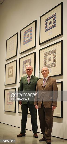 Italian born artist Gilbert Proesch and British artist George Passmore pose for photographers during the press view of the 'THE URETHRA POSTCARD ART'...