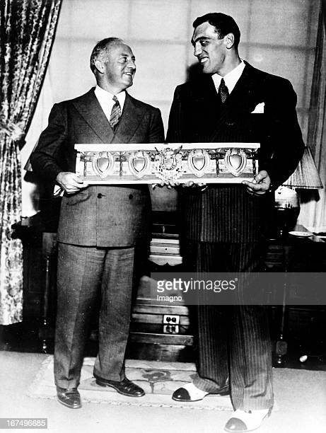 Italian boxer and 1933/34 world heavyweight champion Primo Carnera receives the World Championship belt in New York after his victory over Jack...