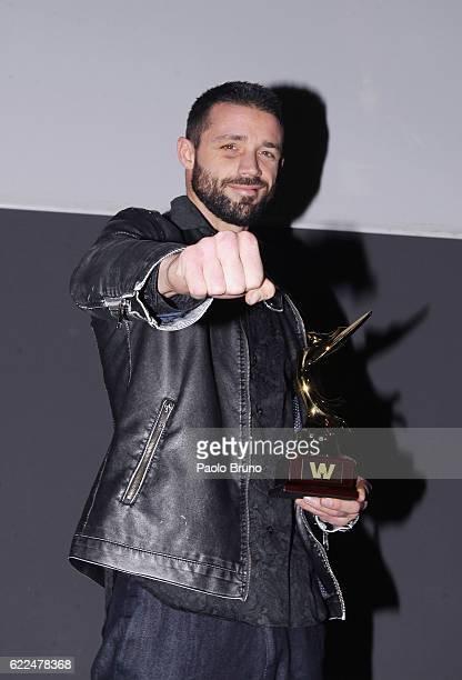 Italian boxer Giovanni De Carolis poses showing the award during the Winning Attitude Award ceremony at Villa Carpegna on November 11 2016 in Rome...