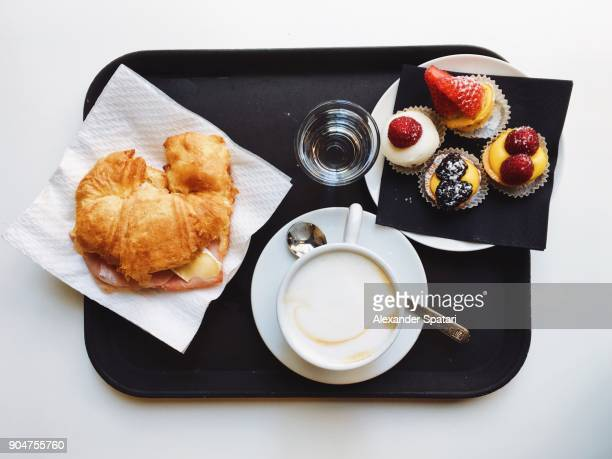 italian breakfast with croissant, cheese, prosciutto, variation of pastries and cappuccino - serving tray stock pictures, royalty-free photos & images