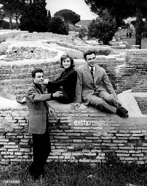 Italian brothers and actors Armando, Germana and Luciano Francioli visiting the excavations in Ostia Antica. Ostia Antica, June 1962