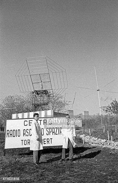 'Italian brothers and radio amateurs Achille and Giovanni Battista Judica Cordiglia standing in front of Bert Tower their space listening centre...