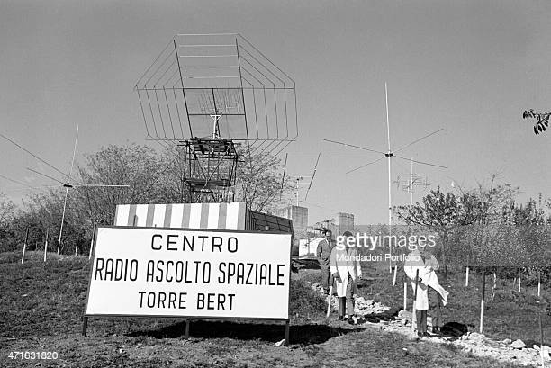 'Italian brothers and radio amateurs Achille and Giovanni Battista Judica Cordiglia walking in front of Bert Tower their space listening centre...