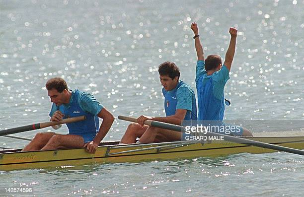 Italian brothers Carmine Abbagnale and Giuseppe Abbagnale seem exhausted after the arrival ot the men's coxed pairs final of the summer Olympics, on...