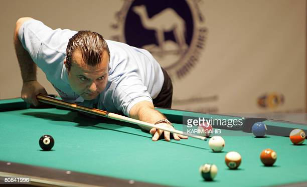 Italian Bruno Muratore sets up a shot during his match against Russia's Ruslan Chinahov at the World 8Ball pool championship in the Gulf Emirate of...