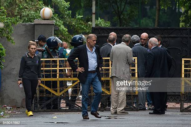 Italian businessman Gianni Boschetti leaves the front gate of the Holey Artisan Bakery after he and Italian government officials visited the site of...