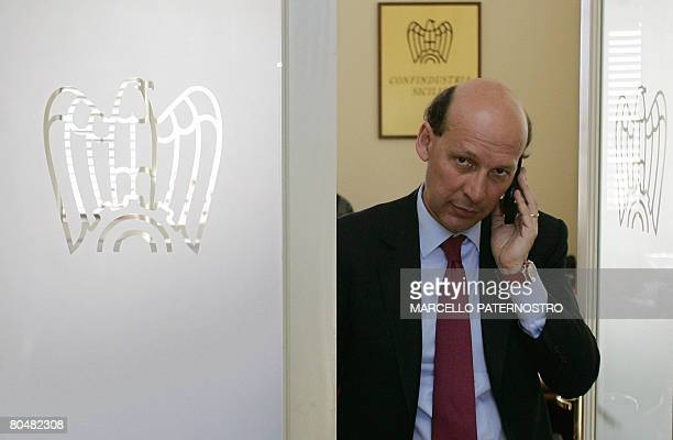 Italian businessman Ivanhoe Lo Bello, president of Sicily's Confindustria employers' association, gives a phone call during an interview with AFP in...
