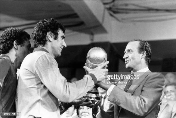Italian captain and goalkeeper Dino Zoff is handed the World Cup trophy from Spanish king Juan Carlos . Italy wins the final of the World Cup against...