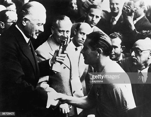 Italian captain Giuseppe Meazza receives the Jules Rimet trophy after his team's 42 victory over Hungary in the World Cup final at the Stade...