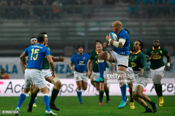 Italian captain number eight Sergio Parisse catches the ball during a Rugby union test match between Italy and South Africa at the Euganeo Stadium in...