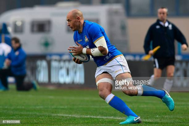 Italian captain number eight Sergio Parisse runs with the ball during a Rugby union test match between Italy and South Africa at the Euganeo Stadium...