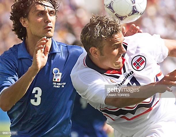 Italian captain Paolo Maldini fights for the ball with Norwegian Havard Flo at the Stade Velodrome in Marseille south of France during their 16th...