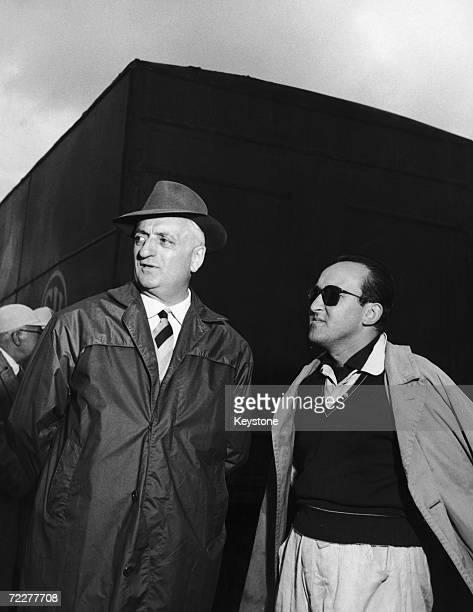 Italian car manufacturer Enzo Ferrari with driver Piero Carini at Monza during trial runs for the Grand Prix 11th September 1953