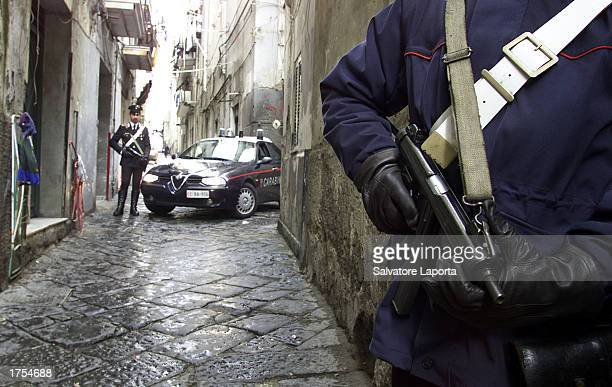 Italian carabiniere patrol the streets where 28 Pakistani were arrested January 31 2003 in Naples Italy Large quantities of explosives forged...