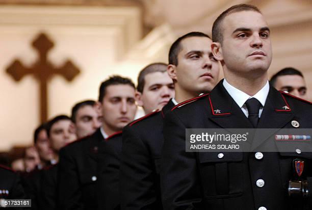 Italian carabinieri attend a souvenir mass remembering the first anniversary of the tragedy in Nassiryah Iraq where 19 Italian carabinieri were...