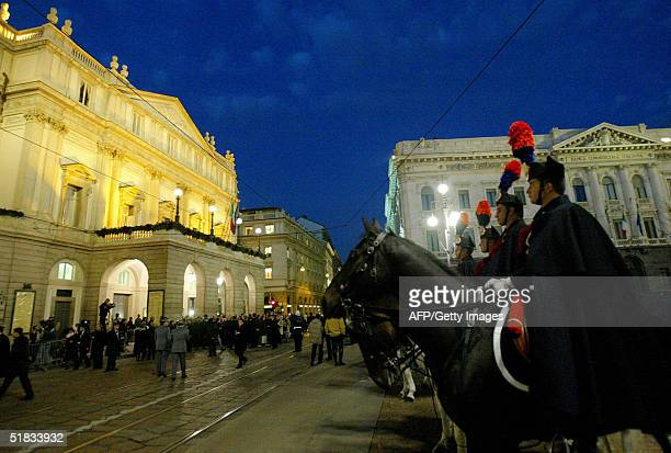 Italian Carabinieri form an honor guard in front of La Scala opera house in Milan during the official inauguration for the reopening of the restored...