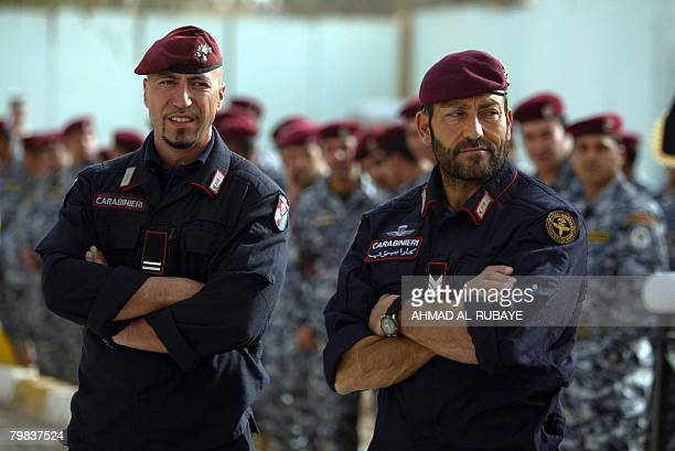 Italian Carabinieri look on during a graduation ceremony for Iraqi National Police from an eightweek training course administered by the Italian...