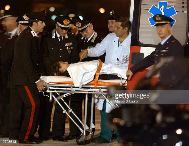 Italian Carabinieri Marilena Iacobini. One of the Italians wounded in a bomb attack in the southern Iraqi town of Nasiriyah, is greeted by officials...