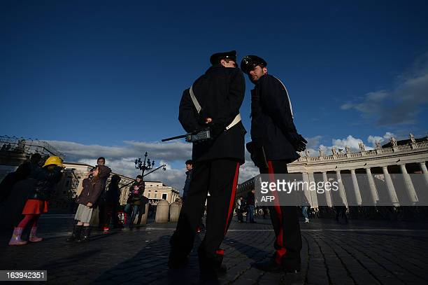 Italian carabinieri policemen patrol at St Peter's square on March 18 2013 at the Vatican on the eve of Pope Francis inauguration mass The leader of...