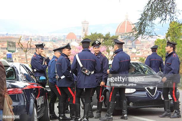 Italian Carabinieri policemen with your Alfa Romeos here in Firenze Florence Tuscany Italy