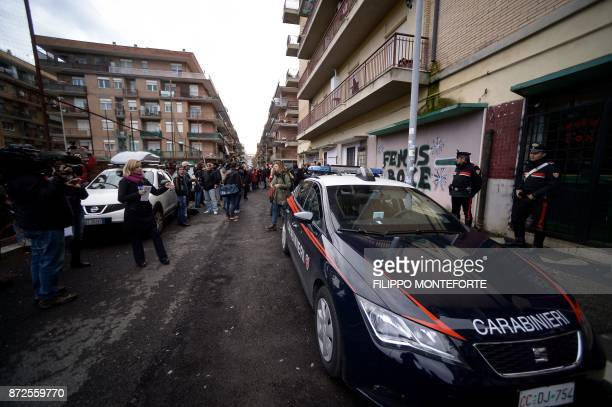 Italian Carabinieri stand alert during a demonstration by Italian journalists held to defend the right to freedom of speech in Ostia on November 10...