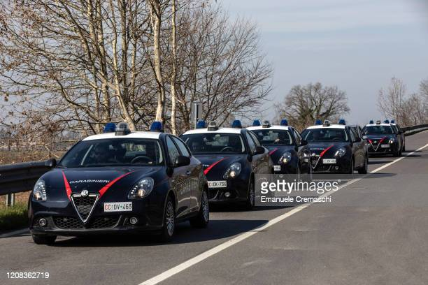 Italian Carabinieri vehicles drive towards an area under quarantine on February 24 2020 in Casalpusterlengo southwest Milan Italy Casalpusterlengo is...