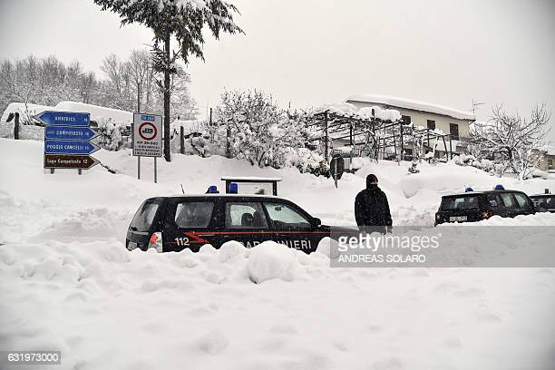 Italian Carabinieri vehicles wait in the snow of a central street of Aringo near Montereale after a 57magnitude earthquake struck the region on...