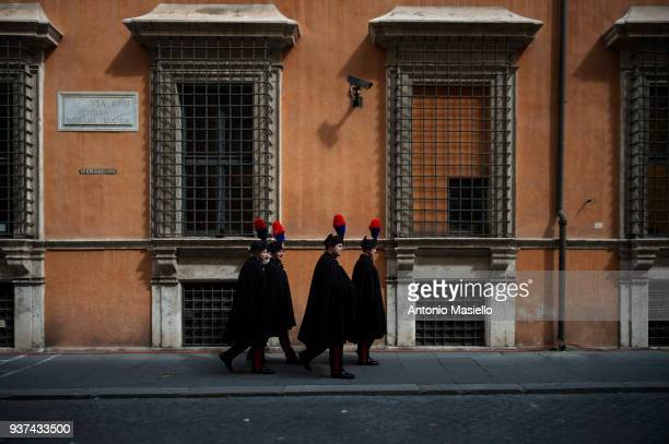 Italian Carabinieri walk near the Italian Senate during the election of Senate's President on March 24 2018 in Rome Italy