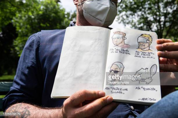 Italian cartoonist Cristian Neri draws various types of use for safety face masks on May 17, 2020 in Milan, Italy. In Italy the use of masks is...