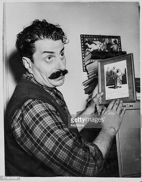 Italian cartoonist Giovanni Guareschi in his office being sued by exPrime Minister Alcide de Gasperi for slander January 26th 1954