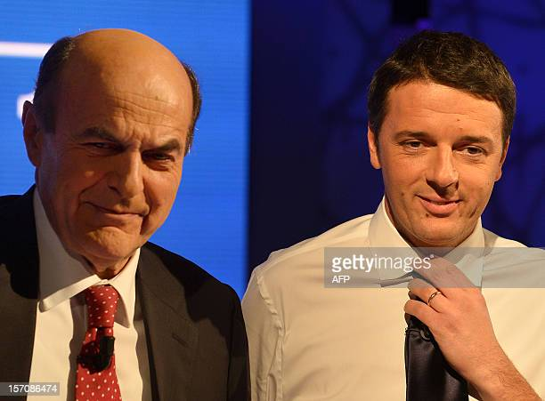 Italian centreleft Democratic Party chief Pier Luigi Bersani and Florence's mayor Matteo Renzi arrive for their television face to face duel at...