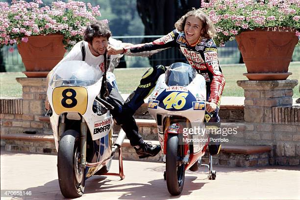 """""""Italian champion Valentino Rossi photographed with his father Graziano, also a professional motorcycle racer in his youth, pretending to hit him..."""