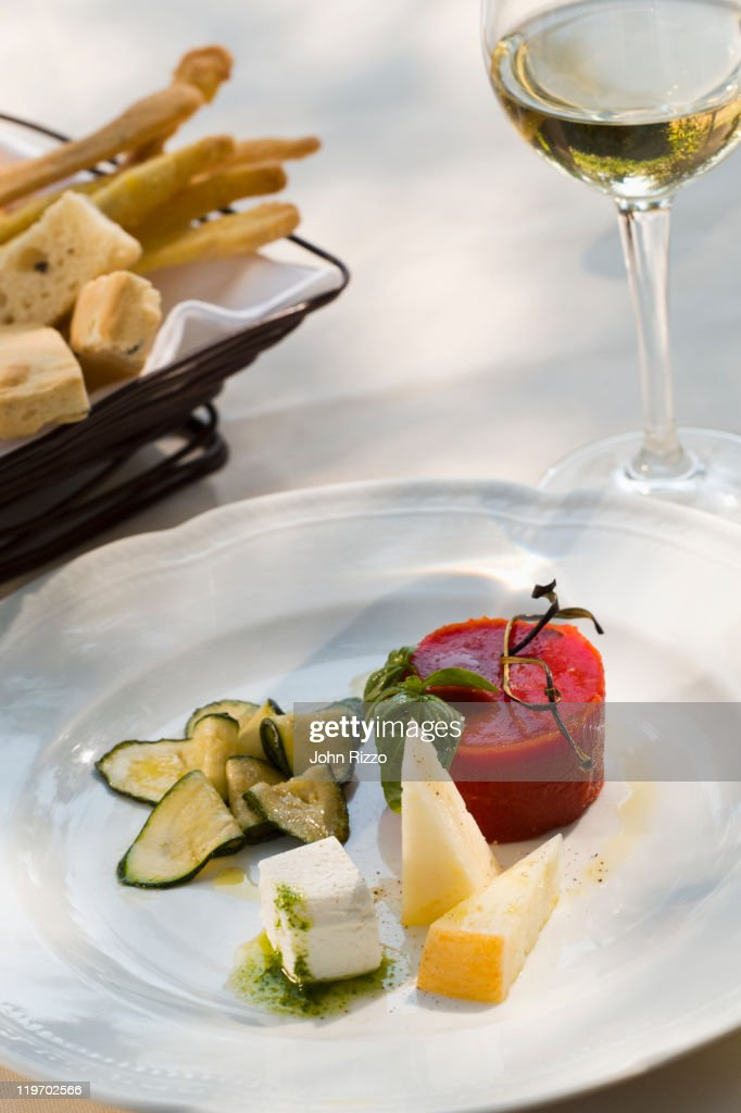 & Italian Cheese Plate With Tomato Aspic Stock Photo | Getty Images