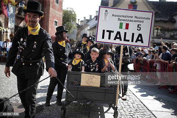 Italian chimney sweeps take part in a parade as part of the 33th International Meeting of Chimney Sweeps in the small village of Santa Maria Maggiore...