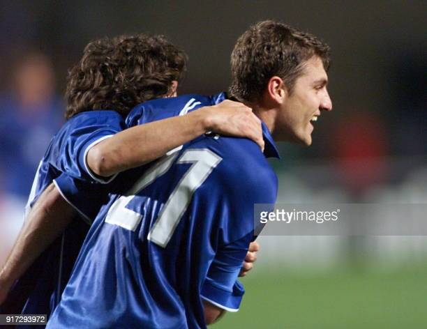 Italian Christian Vieri is congratulated by teammate Alessandro Del Piero after scoring the third goal for the Italian side 17 June at the Stade de...
