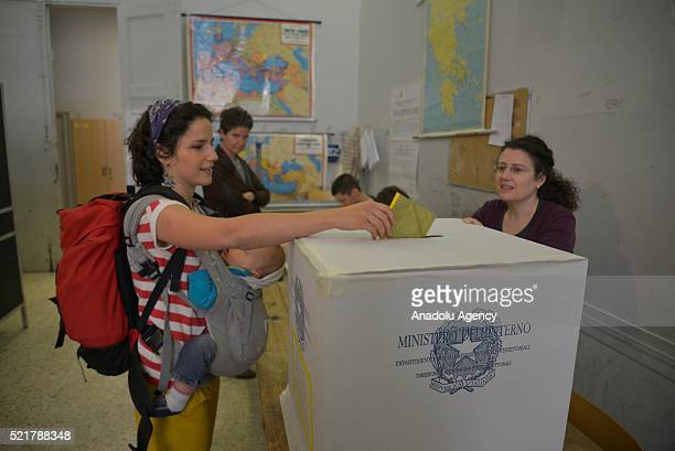 Italian citizens cast their votes during a referendum on off-shore oil and gas drilling rights in the Italian waters, at a polling station, in Rome,...