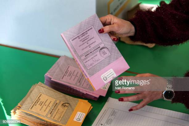 Italian citizens go to the polls to cast their votes to elect a new Italian government on March 4 2018 in Pontecagnano Faiano Italy The economy and...