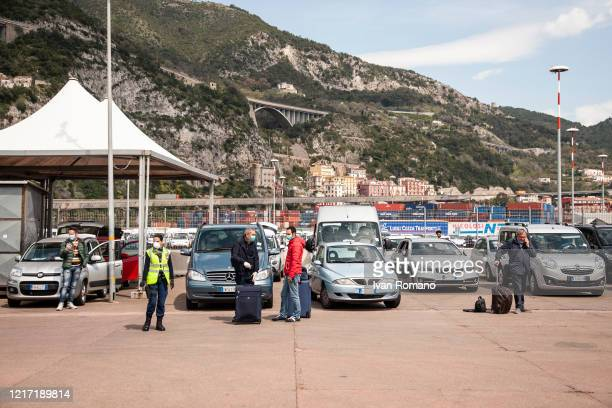 Italian citizens waits to be able to leave for its residence after disembarking from the Catania ship during the covid19 emergency on April 6 2020 in...