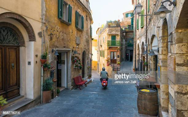 italian city campiglia marittima - moped stock photos and pictures