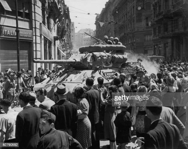 Italian civilians line the streets as an M10 tank destroyer of the US Army enters Rome with the fall of the city to the Allies, 12th June 1944.