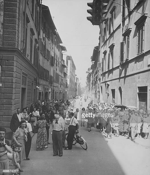 Italian civilians queuing for bread on Via Guelfa, following the allied liberation during World War Two, Florence, Italy, 1944.