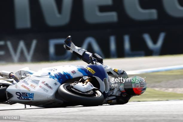 Italian Claudio Corti of the Italtrans Racing Team crashes during the qualifying rounds of the Moto2 on the circuit in Assen on June 29 2012 AFP...