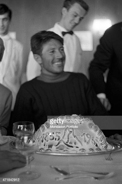 'Italian climber Walter Bonatti celebrating at the restaurant his winter solo ascent on the North wall of Monte Cervino In the middle of the table a...