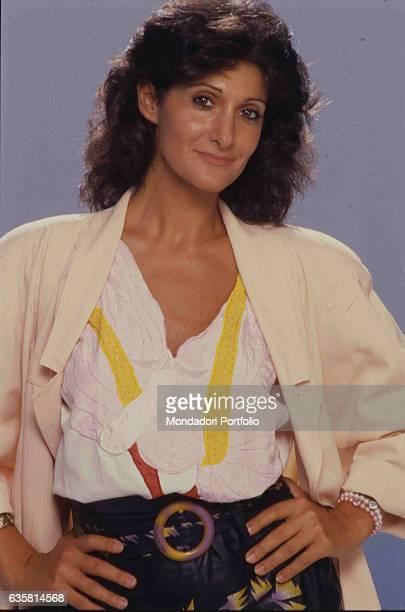 Italian comedian Anna Marchesini posing for a studio photo shooting. Italy, 1985