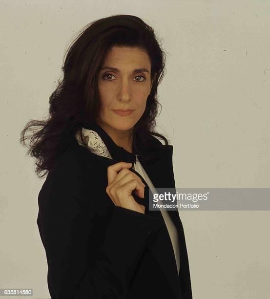 Italian comedian Anna Marchesini posing for a studio photo shooting. Italy, 1995