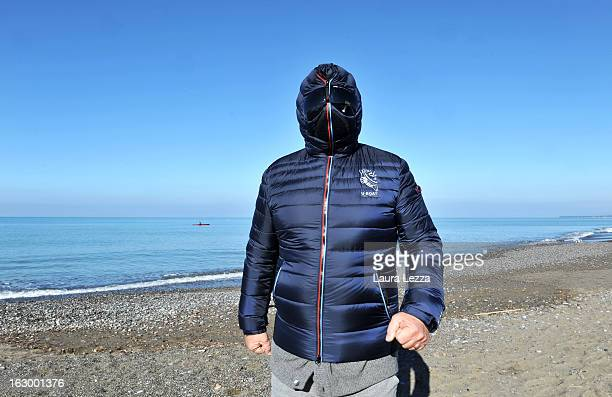 Italian comedian blogger and political leader of the Five Stars Movement Beppe Grillo runs on the beach on March 3 2013 in Marina di Bibbona near...